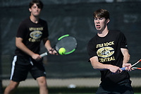 Little Rock Centrals' Alex Wells (right) returns a shot Tuesday, Oct. 12, 2021, as he and his doubles partner Stefan Tudoreanu compete during the 6A state tennis finals at Memorial Park in Bentonville. Visit nwaonline.com/211013Daily/ for today's photo gallery.<br /> (NWA Democrat-Gazette/Andy Shupe)