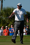 DORAL, FL. - Phil Mickelson putts for birdie during final round play at the 2009 World Golf Championships CA Championship at Doral Golf Resort and Spa in Doral, FL. on March 15, 2009