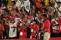 South Korea fans celebrate a goal during the FIFA Under 20 World Cup Group C match between the United States and South Korea at the Mubarak Stadium on October 02, 2009 in Suez, Egypt. The US team lost 3-0.