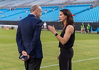 CHARLOTTE, NC - OCTOBER 3: Tom King talks with General Manager Kate Markgraf of the United States during a game between Korea Republic and USWNT at Bank of America Stadium on October 3, 2019 in Charlotte, North Carolina.