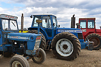 BNPS.co.uk (01202) 558833. <br /> Pic: Cheffins/BNPS<br /> <br /> Pictured (from left): A Ford 7000 sold for £34,840, a 1983 County 1474 sold for £210,112 and a 1974 Massey Ferguson 1200 sold for 27,872. <br /> The top selling lot was a 1983 County 1474 (PICTURED CENTRE) which has done less than 100 hours in the past 25 years. It fetched £210,100<br /> <br /> A farming family is today celebrating after their incredible collection of almost 100 vintage tractors sold for a staggering £1million.<br /> <br /> Father and son duo Ian and Martin Liddell began hoarding the agricultural vehicles at their arable farm in the 1980s.<br /> <br /> Their fleet of tractors was so large that they had to be stored in three barns.<br /> <br /> The prized collection sparked a worldwide bidding war when it was sold with auctioneers Cheffins, of Cambridge, after the family decided to part with the tractors to free up space on their Essex farm to pursue other projects.