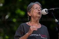 """Haidi Giuliani, Mother of Carlo Giuliani.<br /> <br /> Memoria è Lotta (Memory is Struggle); Per Non DimentiCarlo (To Not Forget Carlo).<br /> <br /> Presidio in Piazza Alimonda, Rally in Piazza Alimonda (AKA Piazza Carlo Giuliani, Ragazzo) where at 17:27 of the 20th July 2001 the 23-year-old-demonstrator Carlo Giuliani - who was carrying over his head a fire extinguisher - was killed by firearm bullets shot by the 20-year-old Carabinieri's (police) officer Mario Placanica and then run over twice by a Carabinieri's Land Rover.<br /> <br /> Genoa, Italy. 19, 20, 21 July 2021. Twenty years after the dramatic and terrifying events related to the 2001 Genoa's G8 meeting, according to Amnesty International: """"the most serious suspension of democratic rights in a Western country since the Second World War"""" (1.) and as stated on the 2001 """"Report on the situation of fundamental rights in the EU"""" the European Parliament """"deplores the suspensions of fundamental rights that took place during public demos, and in particular at the G8 meeting in Genoa, such as freedom of expression, freedom of movement, the right to physical integrity"""" (2.). As a reminder, the City of Genoa is State Gold Medal (Medaglia D'Oro) for its Antifascist Resistance in World War II.<br /> Some photos, part of this story, are presented appositely in Black & White to show to the audience """"the Places"""" where the majority of - the already mentioned (see above) - """"suspensions of fundamental rights […] such as freedom of expression, freedom of movement, the right to physical integrity"""" (2.) happened.<br /> ...<br /> <br /> FULL CAPTION & LINKS AT THE BEGINNING OF THIS STORY.<br /> <br /> Footnotes, Links:<br /> <br /> 1. http://bit.do/fRvdg<br /> 2. http://bit.do/fRvdi<br /> <br /> http://www.veritagiustizia.it/doc_eng/<br /> https://www.carlogiuliani.it<br /> https://en.wikipedia.org/wiki/Death_of_Carlo_Giuliani<br /> The bloody battle of Genoa (Source, The Guardian, 2008): http://bit.do/fRvB2"""