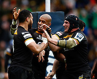 Photo: Richard Lane/Richard Lane Photography. London Wasps v Bath Rugby. Amlin Challenge Cup Semi Final. 27/04/2014. Wasps' Will Helu celebrates his try with Tom Varndell and Carlo Festuccia.