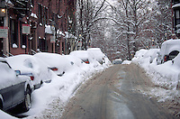 Beacon Hill street scene with several snowed-in parked cars after a heavy snowfall. Boston, Massachusetts.