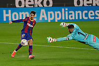 13th February 2021; Camp Nou, Barcelona, Catalonia, Spain; La Liga Football, Barcelona versus Deportivo Alaves; Machado Trincão FC Barcelona shoots past Deportivo keeper Pacheco