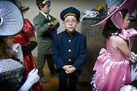 A child dressed up as a sailor back stage at the Children's Tableau, part of the annual Mardi Gras celebration in Montegut, Louisiana. Children dress in costume and are presented to the public in the schools auditorium.