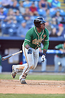 Greensboro Grasshoppers first baseman Lazaro Alonso (46) swings at a pitch during a game against the Asheville Tourists at McCormick Field on May 10, 2018 in Asheville, North Carolina. The Tourists defeated the Grasshoppers 14-10. (Tony Farlow/Four Seam Images)
