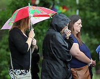 Pictured: Mourners attend the burial of baby Sion at Thornhill Cemetery, Cardiff, Wales, UK. Tuesday 28 June 2016<br /> Re: The funeral of Sion, the baby boy found dead in the River Taff in Cardiff has taken place<br /> Generous locals raised nearly £1,400 for the memorial after reading about plans to hold a fitting ceremony for the newborn baby whose body was discovered in Cardiff a year ago.<br /> The funeral took place at the Briwnant Chapel at Thornhill Crematorium, Cardiff. Members of the public are invited to be among the congregation.