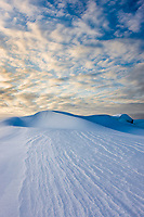 Large snow drifts on Barter Island in the Arctic National Wildlife Refuge, Alaska.