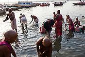 Hindu pilgrims offer prayers and bathe on the ghats in the ancient city of Varanasi in Uttar Pradesh, India. Photograph: Sanjit Das/Panos