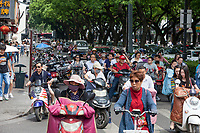 Suzhou, Jiangsu, China.  Afternoon Motorbike Traffic; Going Home after Work.