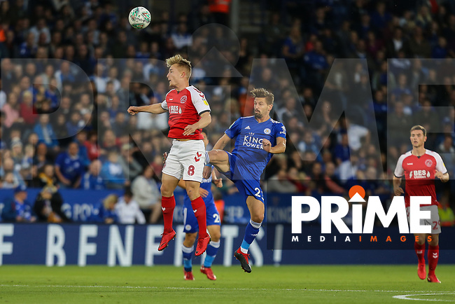 Kyle Dempsey of Fleetwood Town beats Adrien Silva of Leicester City in the aerial battle during the English League Cup Round 2 Group North match between Leicester City and Fleetwood Town at the King Power Stadium, Leicester, England on 28 August 2018. Photo by David Horn.