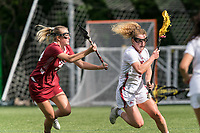 NEWTON, MA - MAY 14: Amy Moreau #3 of University of Massachusetts brings the ball forward as Taylor Moncman #34 of Temple University defends during NCAA Division I Women's Lacrosse Tournament first round game between University of Massachusetts and Temple University at Newton Campus Lacrosse Field on May 14, 2021 in Newton, Massachusetts.