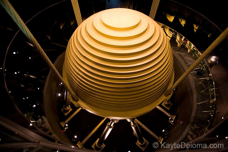 The damper in Taipei 101 that helps absorb motion in the high rise, is a tourist attraction in itself. Taipei, Taiwan, ROC