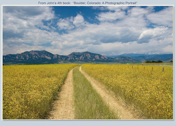 Country road in Boulder Valley, with a Rocky Mountains backdrop. <br />