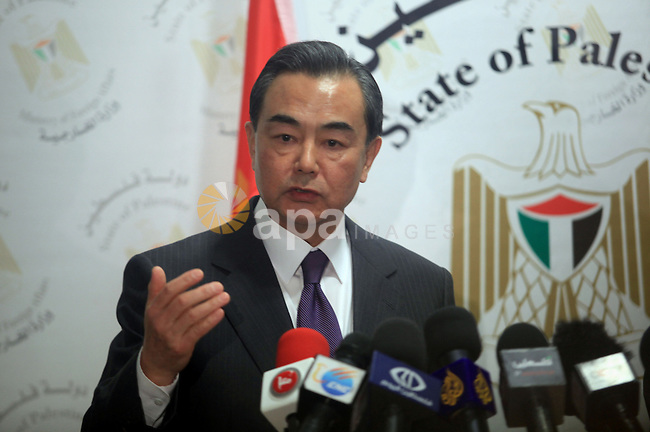 Chinese Foreign Minister Wang Yi speaks as he delivers joint statements with his Palestinian counterpart Riad Malki  in the West Bank city of Ramallah December 18, 2013. Photo by Issam Rimawi