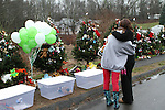 NEWTOWN, CT-17 December 2012-121712LW08 - Mourners comfort each other at the evergreen memorials near the entrance of Sandy Hook Elementary School  in Newtown Monday. Laraine Weschler