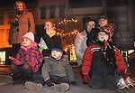 A group of musicians draws a crowd during Christmas on the Green in downtown Piqua on Friday evening. From left to right, Sherry Heath of Piqua, Isabella Slocombe, 3, and Sebastian, 2, and their mother Annalisa of Great Britain, Natalee Heath and her children Joshua, 4, and Nichola, 7 of Piqua.