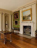 One end of the gallery features a stone fireplace flanked by a pair of antique benches