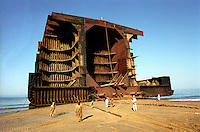 The hull of a huge ship in the process of being demolished at the Gaddani ship-breaking yard.
