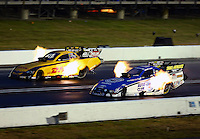 Aug. 31, 2013; Clermont, IN, USA: NHRA funny car driver Robert Hight (near lane) races alongside Del Worsham during qualifying for the US Nationals at Lucas Oil Raceway. Mandatory Credit: Mark J. Rebilas-