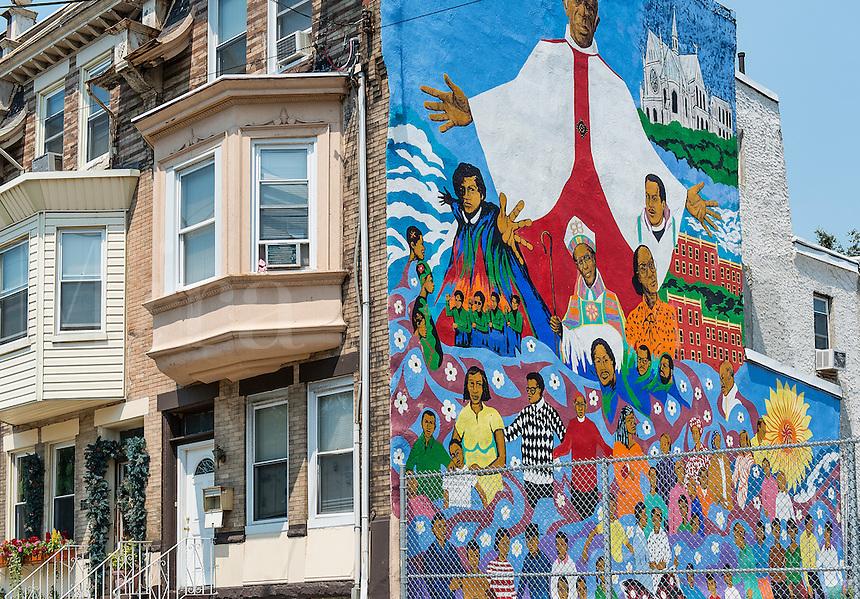 Attractive mural on the side of an urban row home, Philadelphia, Pennsylvania, USA