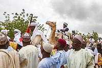 Muslim pilgrims leave the prayer ground after performing their morning prayers. Argungu, Nigeria.