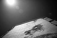 """Nagorny-Karabach, 17.05.2011, Shushi. Ein Fenster in einem Wohnblock, eingebaut in ein Granatenloch. """"The Twentieth Spring"""" - ein Portrait der s¸dkaukasischen Stadt Schuschi, 20 Jahre nach der Eroberung der Stadt durch armenische K?mpfer 1992 im B¸gerkrieg um die Unabh?ngigkeit Nagorny-Karabachs (1991-1994). A new window in a shell hole at a side wall of a appartment house. """"The Twentieth Spring"""" - A portrait of Shushi, a south caucasian town 20 years after its """"Liberation"""" by armenian fighters during the civil war for independence of Nagorny-Karabakh (1991-1994). .Une nouvelle fenêtre dans un trou d'obus lors d'une paroi latérale d'un immeuble. """"Le Vingtieme Anniversaire"""" - Un portrait de Chouchi, une ville du Caucase du Sud 20 ans après sa «libération» par les combattants arméniens pendant la guerre civile pour l'indépendance du Haut-Karabakh (1991-1994)..© Timo Vogt/Est&Ost, NO MODEL RELEASE !!"""