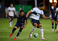 LAKE BUENA VISTA, FL - JULY 26: Theo Bair of Vancouver Whitecaps FC turns away from Luis Martins of Sporting KC during a game between Vancouver Whitecaps and Sporting Kansas City at ESPN Wide World of Sports on July 26, 2020 in Lake Buena Vista, Florida.