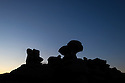 Silhouettes of the Crow Stones before sunrise. Peak District National Park, Derbyshire, UK. August.