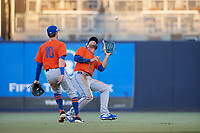 St. Lucie Mets center fielder Desmond Lindsay (2) catches a shallow fly ball as Cody Bohanek (10) backs up the play during a Florida State League game against the Tampa Tarpons on April 10, 2019 at George M. Steinbrenner Field in Tampa, Florida.  St. Lucie defeated Tampa 4-3.  (Mike Janes/Four Seam Images)