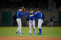 Rancho Cucamonga Quakes outfielders Logan Landon (6), Jeren Kendall (3), and Saige Jenco (9) celebrate a victory after a California League game against the Stockton Ports at Banner Island Ballpark on May 16, 2018 in Stockton, California. Rancho Cucamonga defeated Stockton 6-3. (Zachary Lucy/Four Seam Images)
