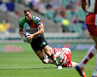 Karl Dickson of Harlequins 7s escapes the tackle of Joe Murphy of Gloucester Rugby 7s during the World Club 7s at Twickenham on Sunday 18th August 2013 (Photo by Rob Munro)