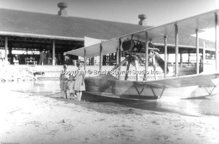 Presque Isle PA:  Stewart children standing in front of a mail delivery airplane. The plane was a Canadian Vickers seaplane used to deliver mail to islands along Lake Erie.