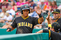 Indianapolis Indians outfielder Christopher Bostick (7) gets high fives from the dugout during an International League game against the Buffalo Bisons on July 28, 2018 at Victory Field in Indianapolis, Indiana. Indianapolis defeated Buffalo 6-4. (Brad Krause/Four Seam Images)