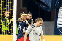 FOXBOROUGH, MA - SEPTEMBER 23: Diego Fagundez #14 of New England Revolution celebrates his goal with teammates during a game between Montreal Impact and New England Revolution at Gillette Stadium on September 23, 2020 in Foxborough, Massachusetts.