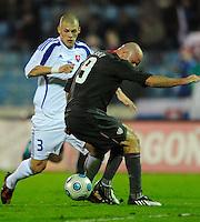 Conor Casey (9) battles for the ball against Martin Skrtel (3). Slovakia defeated the US Men's National Team 1-0 at the Tehelne Pole in Bratislava, Slovakia on November 14th, 2009.