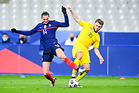 24th March 2021; Stade De France, Saint-Denis, Paris, France. FIFA World Cup 2022 qualification football; France versus Ukraine;  Adrien Rabiot (France) collides with Oleksandr Karavayev (Ukraine)