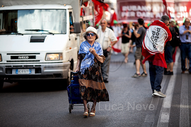 Unknwon, Protester.<br /> <br /> Rome, 01/05/2019. This year I will not go to a MayDay Parade, I will not photograph Red flags, trade unionists, activists, thousands of members of the public marching, celebrating, chanting, fighting, marking the International Worker's Day. This year, I decided to show some of the Workers I had the chance to meet and document while at Work. This Story is dedicated to all the people who work, to all the People who are struggling to find a job, to the underpaid, to the exploited, and to the people who work in slave conditions, another way is really possible, and it is not the usual meaningless slogan: MAKE MAYDAY EVERYDAY!<br /> <br /> Happy International Workers Day, long live MayDay!