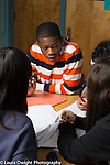 Education high school group of stuents working together discussion in classroom