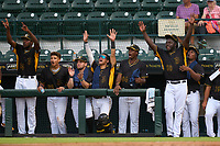 Bradenton Marauders bench, (L-R) Wandi Montout (24), Dariel Lopez (52), Claudio Finol (18), Endy Rodriguez (5), Estalin Ortiz (54), Eddy Yean (30), and Luis Ortiz (41), celebrate during a game against the Fort Myers Mighty Mussels on May 6, 2021 at LECOM Park in Bradenton, Florida.  (Mike Janes/Four Seam Images)