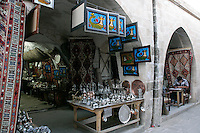 Antique market with framed shahmarans hanging, Mardin, southeastern Turkey