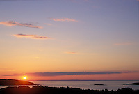 Sunrise from Vasskalven Island in the Oslo Fjord, Norway.  We spend several glorious days here visiting relatives one summer.  This image was taken around 4:00 a.m.