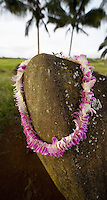 Kukaniloko Birth Stone with orchid lei, sacred stones where Ali'i gave birth, near Wahiawa, Central Oahu