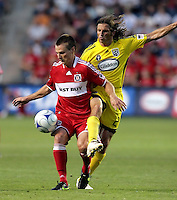 Chicago Fire midfielder Chris Rolfe (17) shields the ball from Columbus Crew defender Frankie Hejduk (2).  The Chicago Fire tied the Columbus Crew 0-0 at Toyota Park in Bridgeview, IL on July 11, 2009.