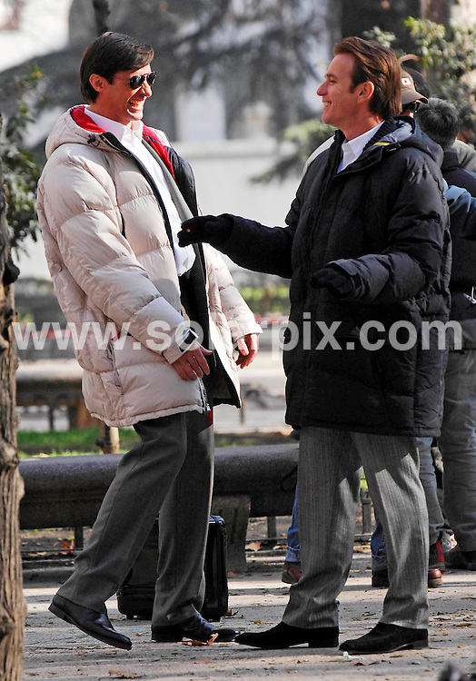 **ALL ROUND PICTURES FROM SOLARPIX.COM**.SYNDICATION RIGHTS FOR UK, CANADA, USA, SOUTH AFRICA, SOUTH AMERICA, DUBAI, AUSTRALIA, NEW ZEALAND, GREECE, ASIA.Pictures show Ewan McGregor and fellow actors Hugh Jackman  and Michelle Williams on location in Madrid for the filming of the forthcoming action thriller 'The Tourist'. The film is directed by Marcel Langenegger and also stars Maggie Q..Pic Shows.HUGH JACKMAN & EWAN MCGREGOR..DATE: 11/01/2007-JOB REF: 3217-SPA.**MUST CREDIT SOLARPIX.COM OR DOUBLE FEE WILL BE CHARGED**