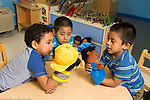 Education Preschool 4-5 year olds group of three boys playing with puppets and talking