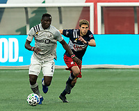FOXBOROUGH, MA - SEPTEMBER 23: Victor Wanyama #2 of Montreal Impact brings the ball forward as Scott Caldwell #6 of New England Revolution defends during a game between Montreal Impact and New England Revolution at Gillette Stadium on September 23, 2020 in Foxborough, Massachusetts.