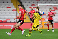 Lincoln City's Tom Hopper vies for possession with Oxford United's Rob Atkinson<br /> <br /> Photographer Chris Vaughan/CameraSport<br /> <br /> The EFL Sky Bet League One - Saturday 12th September 2020 - Lincoln City v Oxford United - LNER Stadium - Lincoln<br /> <br /> World Copyright © 2020 CameraSport. All rights reserved. 43 Linden Ave. Countesthorpe. Leicester. England. LE8 5PG - Tel: +44 (0) 116 277 4147 - admin@camerasport.com - www.camerasport.com - Lincoln City v Oxford United