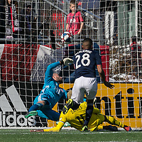 Foxborough, Massachusetts - March 9, 2019:  In a Major League Soccer (MLS) match, Columbus  Crew (yellow) defeated New England Revolution (blue/white), 2-0, at Gillette Stadium.<br /> Gyasi Zardes scores.